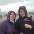 Wet figures in rain gear at Southend Pier.