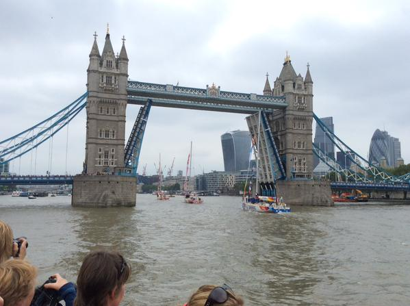 Photograph of Tower Bridge open to allow the boats to pass