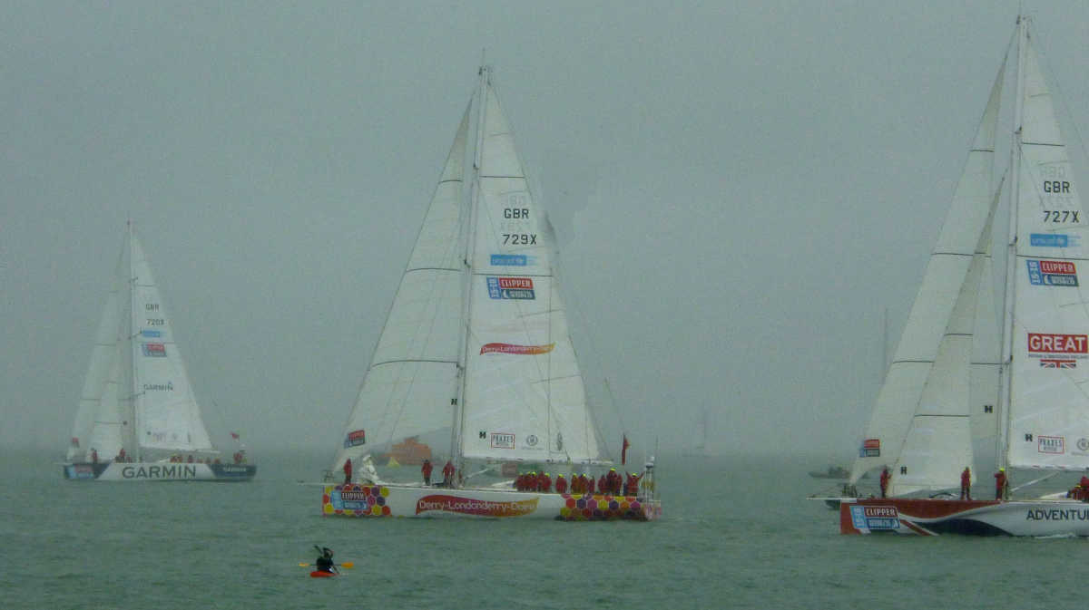 Yachts getting into position at the end of a very rainy Southend Pier