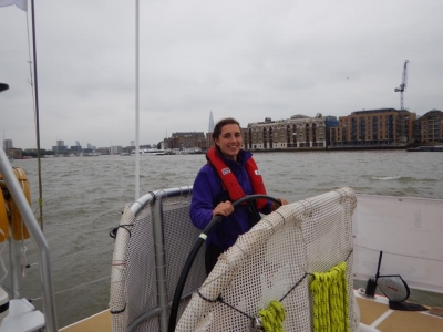 Ruth helming boat on Thames